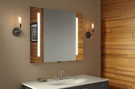 this smart mirror can control a new line of activated gadgets from kohler