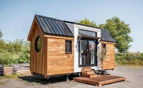 cheap enchanting tiny home combines rustic french charm and modern luxury  with largest tiny house on wheels.
