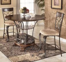 ashley furniture round coffee table alyssa 3 piece counter height dining table set by
