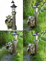 garden dragon with solar lamp figure