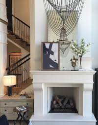 mirror and art over fireplace