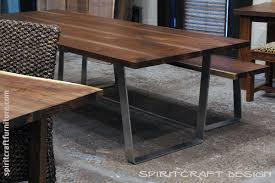 dining table and matching bench from slabs of kiln dried black walnut with mid century modern