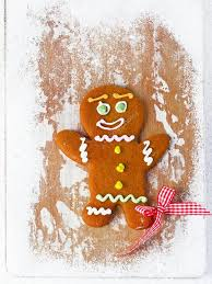 gingerbread man on wooden table stock photo