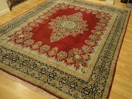 handmade persian kerman red background navy light blue