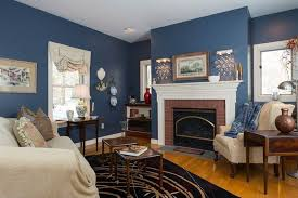 traditional living room with fireplace and painted blue walls