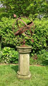 rusted armillary sphere and pedestal