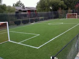 grass soccer field with goal. Synthetic Turf Crumb Rubber Grass Soccer Field With Goal
