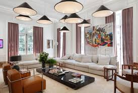 living room pendant lighting ideas. Living Room Multi Cone Shade Pendant Lamps Over White Sectional Sofa And Brown Leather Armchairs Lighting Ideas