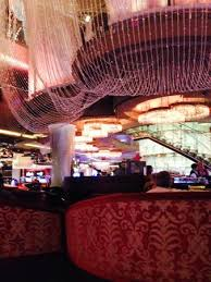 the cosmopolitan of las vegas autograph collection two story crystal chandelier bar