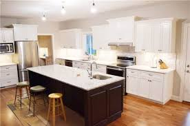 painted perimeter cabinets stained rustic hickory island quartz countertops