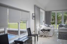 wave curtains with laminated roller blind in matching fabric