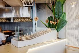 Distinctive Designs Furniture Inc New Bagel Concept In Dubai By H2r Design Combines Greenery