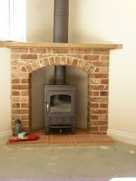 charcoal clearview pioneer wood burning stove in corner fireplace with twinwall flue