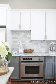 two toned gray and white cabinets marble subway tile carrara countertops a