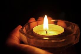 Risultati immagini per candela bianca accesa immagini
