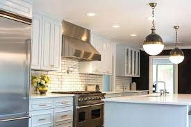 white subway tile backsplash kitchen with stainless accents and tiles gray grout
