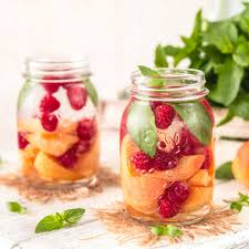 cold fruit infused detox water with apricots raspberrieint