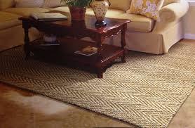 beige kaleen rugs on laminate wood flooring for elegant living room decorating ideas and rustic coffee table plus beige loveseat