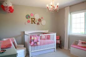 cost friendly simple small baby girl nursery ideas on a budget room chandelier wooden crib drawer ideas baby nursery ideas small