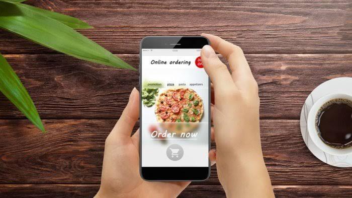 Ilustrasi layanan pesan-antar makanan. Go-Food kini bisa pesan makanan dari kota lain.