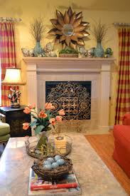 Spring Mantel - with a gold flower mirror, vases off natural ...