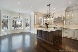 white shaker cabinets dark floors. traditional antique white kitchen cabinets (kitchen-design-ideas.org) shaker dark floors
