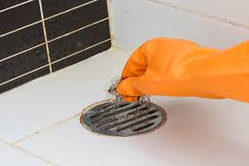 unclogging a shower drain by hand