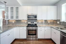 white kitchens with dark backsplash kitchen backslash white kitchen gray metal kitchen kitchen black tile