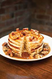 maple pancakes topped with bananas brown sugar spiced walnuts and whiskey maple syrup