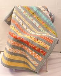 modern handmade baby or toddler quilt in orange blue green yellow aqua