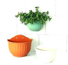 wall mounted planter holder wall hanging planter wall mounted pot holder garden wall mounted plant holders plain color round plastic wall hanging planter