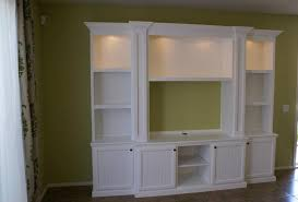 fresh and bright white cabinetry featuring bead board doors and shaker style pillars with the pop