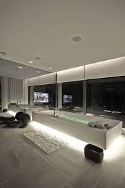 interior home lighting. the bathtub in master bathroom of this home whose interior was designed by tanju zelgin has lighting that been hidden underneath an overhanging i