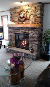 kozy heat bayport gas fireplace with black enamel interior cultured stone southern ledgestone in bucks county color