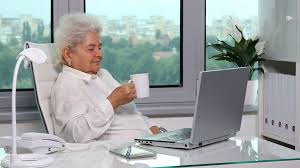 Office relaxation Modern Old Woman Happiness Relaxation Drinking Hot Coffee In Workplace Office Interior Stock Video Footage Storyblocks Video Video Blocks Old Woman Happiness Relaxation Drinking Hot Coffee In Workplace