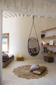 Captivating grid rattan bedroom hanging chair design. #HangingChairs  #Netnoot #Furniture www.