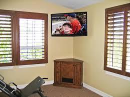 corner tv cabinet c 130 stand to rest below wall mounted regarding mount tv stands designs