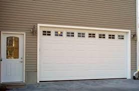 grey garage door design with brick walls | Quecasita