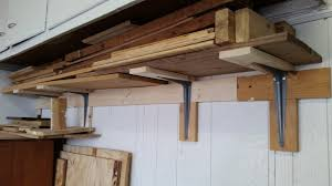 wood storage shelf in garage homediygeek