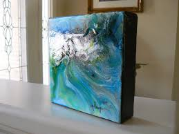 this has a very hard high gloss finish on gallery wrap canvas silver metallic paint brings additional interest and works well with the finish to create an