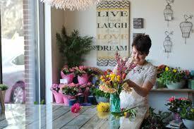 minneapolis florist elishia robson arranging bright flowers jpg
