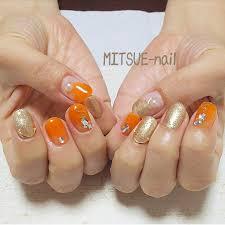 秋らしいオレンジカラーにゴールドを合わせてゴージャスネイル 南行徳