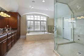 Large Master Bath With Spacious Glass Shower Stock Photo, Picture ...