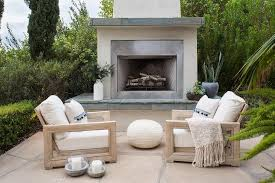 white stucco outdoor fireplace with concrete hearth