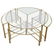 huge round coffee table in brass with four nesting tables by maison charles for