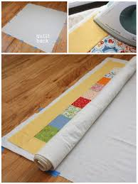 Quilt Along Series: Sewing the Quilt Together | Make and Takes & Smooth the batting and lay your quilt top over the batting. I like to press  both layers together to get all wrinkles out. Doing so also helps the quilt  top ... Adamdwight.com