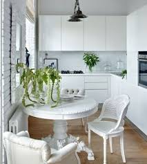 minimalist kitchen decorating ideas with classic white wooden round table and excellent chairs using l shaped cabinet