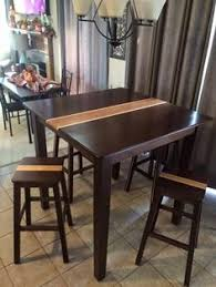 from gary james peruvian walnut bar height table happy customer on thanksgiving