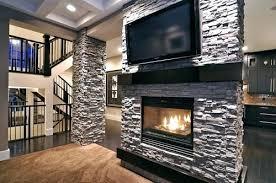 flat screen tv above fireplace brick mounting