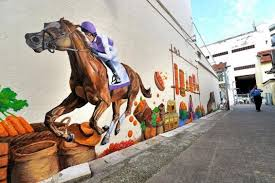 community colours more than 40 people worked on the 20m long community art project which features details from race course road s history as a hub for  on wall mural artist singapore with mural to bring to life race course road heritage latest singapore